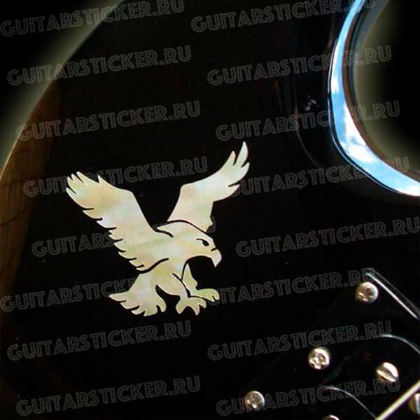 Орел на деку гитары