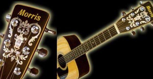Нанести наклейку на голову грифа гитары